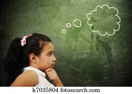 Education activities in classroom at school, smart girl thinking, copy space