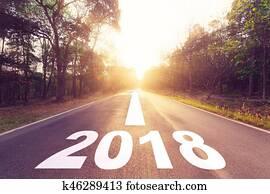 Empty asphalt road and New year 2018 goals concept.