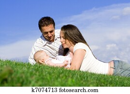 happy family parents and baby
