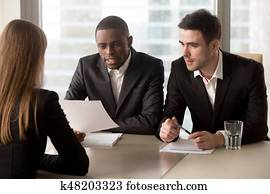 Multiracial black and white headhunters recruiters interviewing