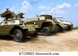 Military cars at work