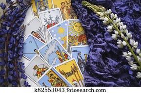 romantic Tarot Setup Background. Tarot cards and Lupin flowers.