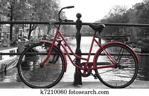 Red European Bike next to river.