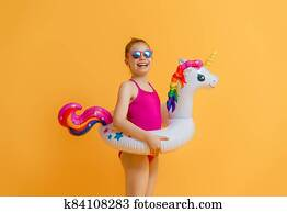 Happy child wearing swimsuit