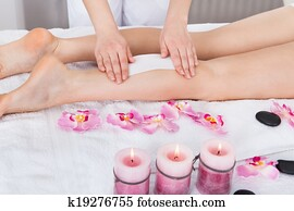 Beautician Waxing Woman's Leg
