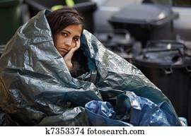 homeless woman having cold
