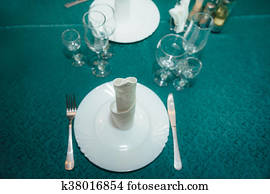 Table set for an event party or wedding reception. Empty glasses in restaurant