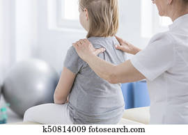 Physiotherapist doing massage to girl