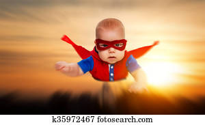 toddler little baby superman superhero with a red cape flying through sky