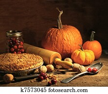 Freshly baked pie with pumpkin , nuts and cranberries