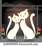 Two cats sitting on the window on the background of the city