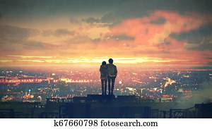 couple standing on the roof top