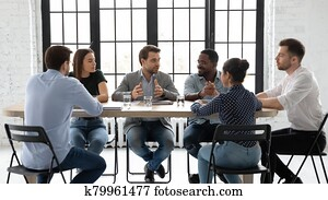Diverse colleagues brainstorm discuss ideas at meeting