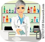 female pharmacist giving pills in blister pack standing in a drugstore in front of medications on showcase