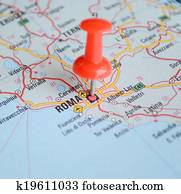 Close up of Rome map with red pin - Travel concept