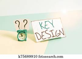 Handwriting text Key Design. Concept meaning a necessary or very important realization of a concept or idea Mini size alarm clock beside a Paper sheet placed tilted on pastel backdrop.