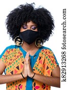 Brazilian girl wearing protective mask to prevent contagion from coronavirus covid-19