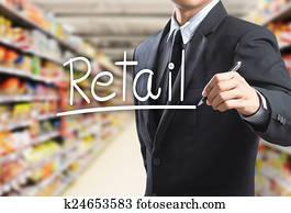 Business man writing word retail