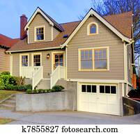 Small new cute brown house with orange doors and windows.