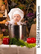4f59a33caf8 Portrait of a baby wearing a chef hat sitting inside a large cooking stock  pot