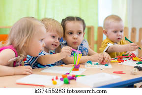 Kids group making arts and crafts in kindergarten