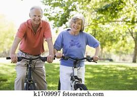 Senior couple on bicycles
