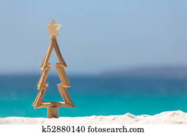 Timber Christmas tree in sand on the beach