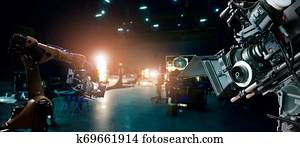 Robotics automatic arms machine of making movie and TV commercial in studio. Camera of movie. Innovation and technology of movie industry with monitoring system software. Film crew team in set.