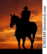 Silhouette cowboy with horse