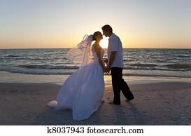Bride & Groom Married Couple Kissing Sunset Beach Wedding