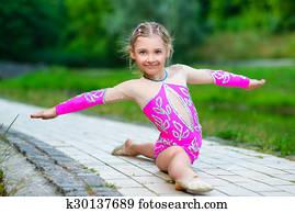 Flexible Little Girl Doing Gymnastics Vertical Split Stock