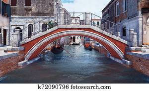 Old stone bridge over water canal in Venice, Italy