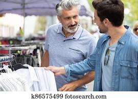 young hipster brothers at weekly cloth flea market