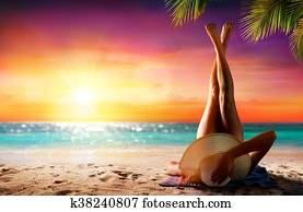 Woman In Relaxation On Beach