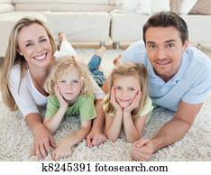Family lying on the carpet