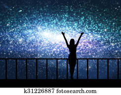 Silhouette of young woman in the cosmos