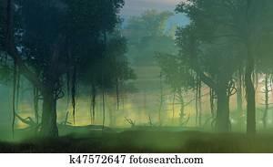 Dark misty forest at dawn or dusk