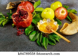 Pomegranate, apples and honey for Rosh Hashanah with horn.
