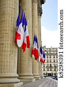 French tricolor flags hang on the Pantheon during the Fete Nationale (Bastille Day)