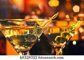 Olive and glass Martini