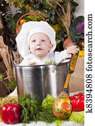 a487d3d11e7 Stock Photograph of 1960s baby making salad wearing chef hat with ...