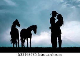 couple and horses at sunset