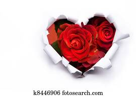 Art bouquet of red roses and the paper hearts on Valentine Day