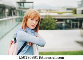 19f95f85d120 Outdoor portrait of pretty little preteen 10-11 year old girl wearing blue  formal dress
