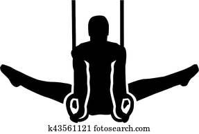 Man exercise at gymnastics rings