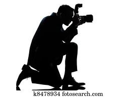 silhouette man kneeling photographer
