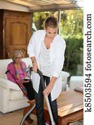 Daughter cleaning for mother