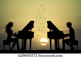 plays to piano at sunset