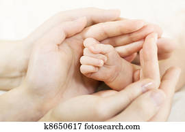 Baby hand into parents hands. Family concept