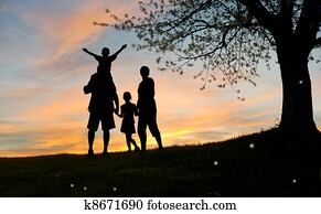 Happy family, father, mother, son and daughter in nature, sunsett